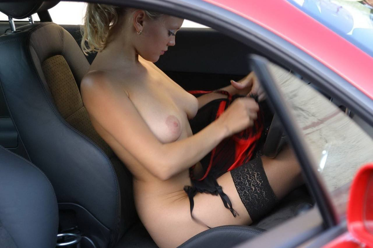 Topless blonde is driving her car and getting insanely horny