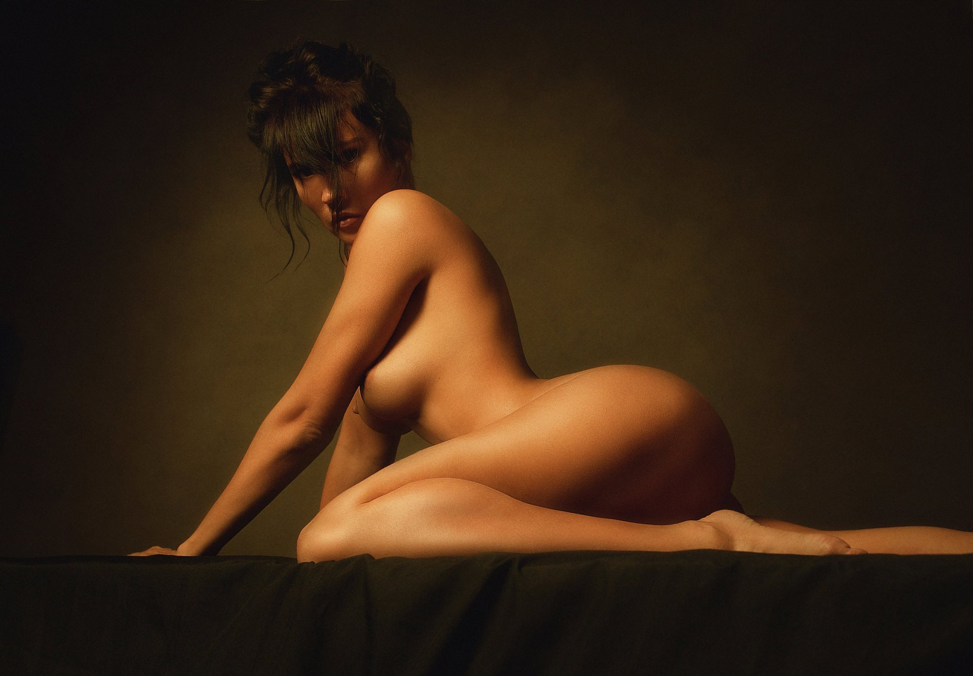 Busty nude woman standing